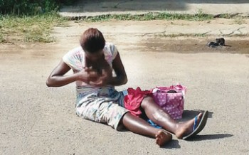 Hungry woman bares breast at court premises in Lagos